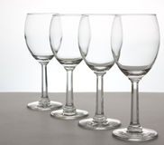 Wine Glasses. A row of 4 wine glasses at an angle Royalty Free Stock Images