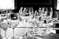 Wine glasses. Black/white image of various wine glasses in a formal setting Royalty Free Stock Photos