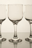 Wine glasses. The contour of three elegant wine glasses on a white background Royalty Free Stock Photography