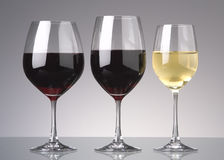 Wine glasses. Three wine glasses with stems, cabernet and chardonay wine Royalty Free Stock Photo
