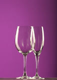 Wine glasses. Two different wine glasses on purple backdrop Stock Images