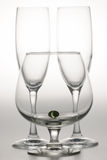 Wine Glasses. Three empty wine glasses and one containg a marble Stock Images