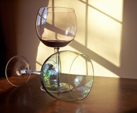 Wine glasses. Different colored wine glasses arranged in different formations Stock Image