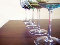 Wine glasses. Different colored wine glasses arranged in different formations Royalty Free Stock Photography