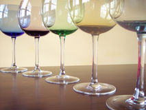 Wine glasses. Different colored wine glasses arranged in different formations Royalty Free Stock Image