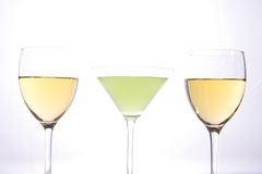 Wine glasses. Wine and martini glasses in studio light Stock Images
