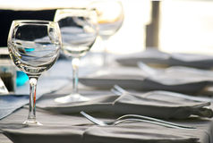 Wine glasses. In row at table Royalty Free Stock Photos