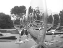 Wine glasses. Black and white wine glasses on a table royalty free stock images