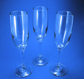 Wine Glasses. Three wine glasses on a bue background stock images
