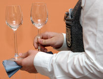 Wine glasses. In hands of waitress stock photo