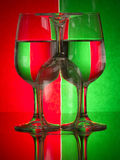 Wine glasses. Set in optical illusion with a background of Christmas colours broken up into pattern stock photos