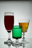 Wine Glasses. Drinks glasses with contrasting shapes and colours Royalty Free Stock Photography
