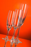 Wine glasses against orange background Royalty Free Stock Photos