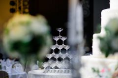 Wine glasses are arranged high in the party. royalty free stock photos