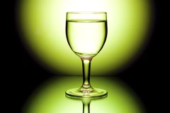 Wine glasses in backlight on the black and yellow Stock Photos