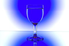 Wine glasses in backlight on the blue and white Stock Photography