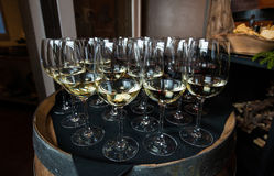 Wine Glasses on a Barrell. Images of filled wine glasses sitting on a barrel stock photography