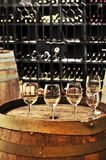 Wine  glasses and barrels Royalty Free Stock Image