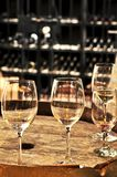 Wine  glasses and barrels Royalty Free Stock Photos