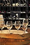 Wine  glasses and barrels Stock Photos