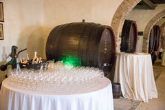 Wine glasses and barrels Stock Images