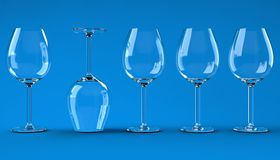 Wine glasses on blue background Royalty Free Stock Photography