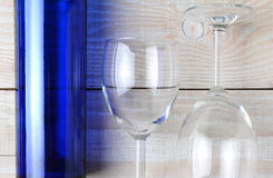 Wine Glasses and Blue Bottle Stock Photos