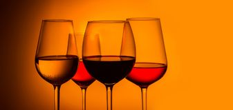 Wine glasses on blue royalty free stock image