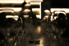 Wine glasses blurred in restaurant bar Stock Images