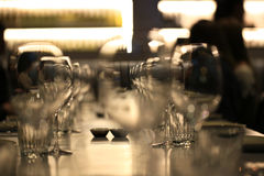 Wine glasses blurred in restaurant bar Royalty Free Stock Images