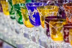 Bohemian crystal glasses. Wine glasses of Bohemian glass in the shop, Prague, Czech Republic stock image