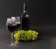 Wine glasses and bottle with grapes Royalty Free Stock Images