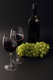 Wine glasses and bottle with grapes Royalty Free Stock Photos