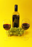 Wine glasses and bottle with grapes Royalty Free Stock Photo