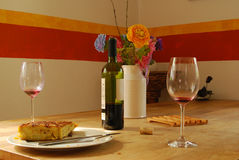 Wine glasses and bottle remain on the table after spanish lunch. Wine glasses and a bottle of red wine remain on the table after a lunch of spanish omelette Royalty Free Stock Photo