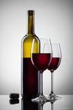 Wine in glasses and bottle on white Royalty Free Stock Photo