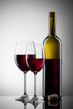Wine in glasses and bottle on white Stock Image