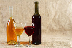 Wine glasses and bottles on vintage background Stock Image
