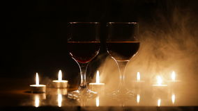 Wine glasses and burning candles in the smoke. stock video footage