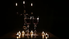 Wine glasses and burning candles. stock footage