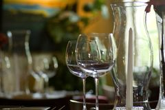 Wine glasses, candle holder. Glassware at fine dining restaurant in Austin, Texas Royalty Free Stock Photo