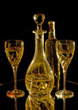 Wine glasses, carafe and bottle of white wine Royalty Free Stock Images