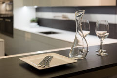 Wine Glasses and Carafe in Kitchen Stock Images