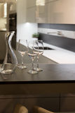 Wine Glasses and Carafe in Kitchen Royalty Free Stock Images