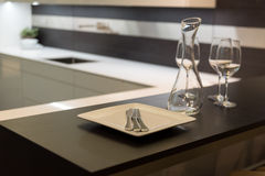 Wine Glasses and Carafe in Kitchen Stock Photos