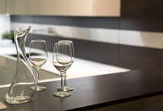 Wine Glasses and Carafe in Kitchen Royalty Free Stock Photography