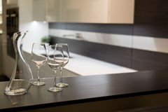 Wine Glasses and Carafe in Kitchen Royalty Free Stock Photo
