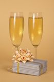 Wine glasses with champagne and beautiful gift box Stock Photo
