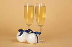 Wine glasses with champagne and New Year's spheres Royalty Free Stock Images