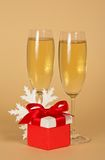 Wine glasses with champagne, a red gift box Royalty Free Stock Image